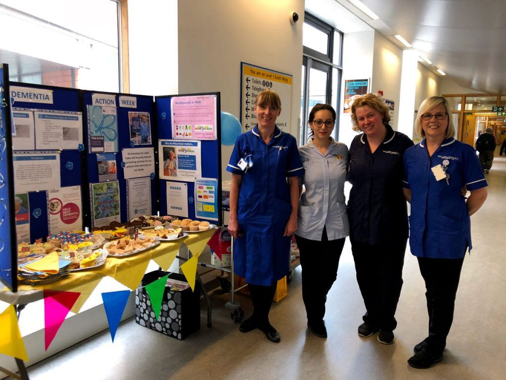 Princess Royal University Hospital staff at the cake and information stand during Dementia Action Week 2018